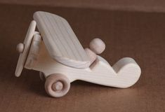 Hey, I found this really awesome Etsy listing at http://www.etsy.com/listing/117487314/handcrafted-wooden-airplane-102