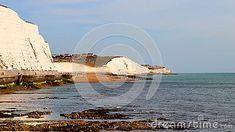view-walkway-under-white-chalk-cliffs-sussex-south-england-bright-blue-sky