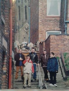 Very rare shot of oasis in Wigan.  1997. St Catherine s church in the back ground, looking up from Darlington​ street.