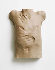 Anders Krisar. It's grotesque and surreal. He takes casts of body parts, and then works magic.