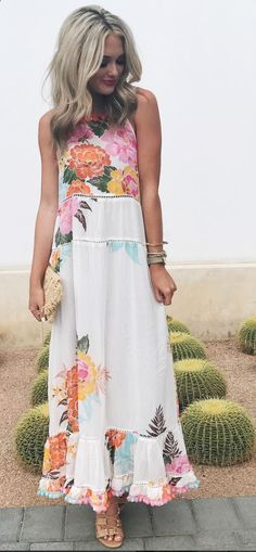 We love this floral dress with pom poms! The bright colors are perfect for summer and major outfit inspiration! It is so fun and cute, it would be great for day time or date night! So stylish!