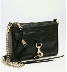 Rebbeca Minkoff's mini mac handbag with the good hardware. It's been in my wishlist for years. Still don't have it yet :( want now. Goes with anything and everything.