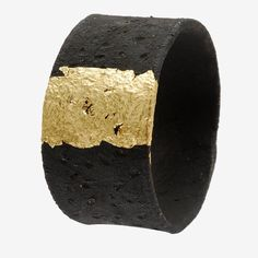 A bracelet made of an unexpected material, black clay. On top of the engraved clay, a gold leaf creates a stark contrast but also evokes a sense of harmony among earth materials. Most objects designed by ceramist Laura Venizelou are made of black clay. She began using it because she was intrigued by its rough, almost volcanic texture. As she states, it is the material itself that leads her to shape forms, as an infinite source of inspiration.