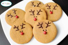 Make these cute reindeer with icing and mini M&Ms.