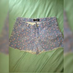 Jordache Faded Blue color Shorts with Pink Roses I am selling some Jordache faded blue shorts. They have pink roses on them and are very cute. Size 14/16 in girls. Fit nicely but I've grown out of them. Jordache Shorts Jean Shorts