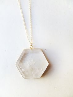 T E S L A - natural crystal quartz geometric hexagon pendant edged in gold. $40.00, via Etsy.