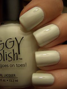 """Piggy Polish in """"6 Impossible Things"""". Not only did I love the Alice In Wonderland reference in the name, this is my choice for the trendy white manicure. It's not stark white, and has a creamy/almost green-grey undertone to it. More wearable, in my opinion."""