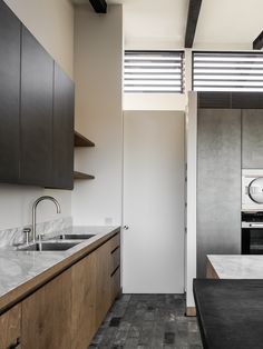 House in the Fields by Stef Claes Warehouse Apartment, Stainless Steel Cabinets, Minimalist Apartment, Ceiling Height, Mid Century House, Brick Wall, White Marble, Kitchen Interior, Interior Inspiration