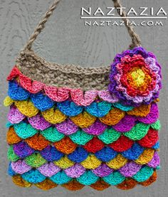 Free Pattern - Crochet Crocodile Stitch Purse. Pattern is for a solid colour bag, but I love this multi-coloured version