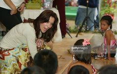 Crown Princess Mary of Denmark talks with with young Thai dancers on her visit to a shelter for hundreds of villagers left homless after the Tsunami April 16, 2005 in Khao Lak, Thailand. The Danish Royals came with an official delegation along with 210 relatives of the Danish victims. Thirty six Danes have been confirmed dead and 10 are still missing. The beach resort of Khao Lak was the worst hit in Thailand by the December 26, 2004 Indian Ocean Tsunami killing more than 5,300 with 2,900…
