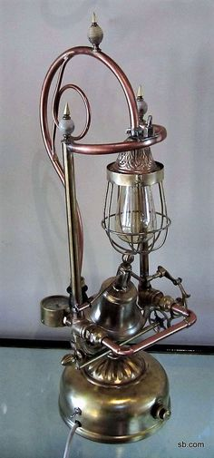 Functional Steampunk lamp for a collector of brass bells.