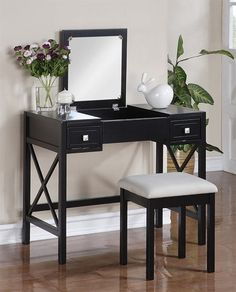 """I know this may seem like a """"duh"""" to others but I didn't think about the benefit of hiding make-up clutter with a flip-top vanity."""