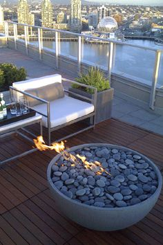 Solus Firebowl firepit- would absolutely LOVE one of these for my back yard- what a classy way to roast marshmallows! They are made in Vancouver - Solus Decor- check them out!