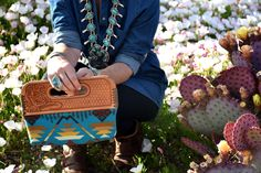 Handmade Clutch by Western Skies Handmade.  Hand-tooled leather top with Pendleton wool body.  Custom order yours today!! WSH is on fb, ig and www.brutonhandmade.com