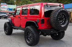 "Custom 2016 Jeep Wrangler Rubicon Unlimited Firecracker Red - AEV 3.5"" DualSport SC Lift kit"