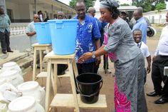 Port Loko Mayor demonstrating how to use the handwashing equipment provided by Plan.