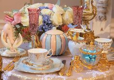 Elegant tea party table setting vintage and antique Cinderella afternoon tea
