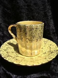 A personal favorite from my Etsy shop https://www.etsy.com/listing/387115520/vintage-cup-yellow-and-gold-with-gold