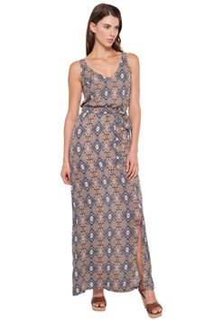 This maxi dress features an all over print with a belted waist.