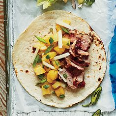 Caribbean Pork Tacos | The combination of salty char-grilled meat with fiery-sweet salsa will make this recipe a family favorite.