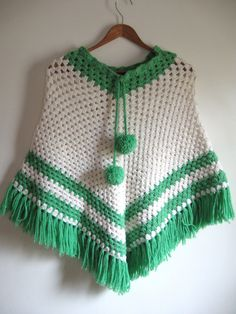 Vintage 1960's/1970's handknit crocheted poncho by HopHopVintage, $40.00. My mom made me a purple one