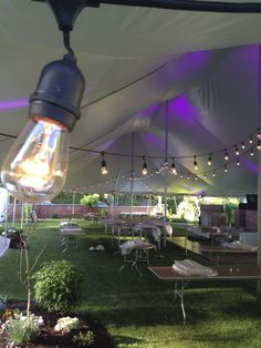 The start of a beautiful set up. Strung lights, lighting, and table decor make outside events even better. #outdoor #tabledecor #lighting #strunglights