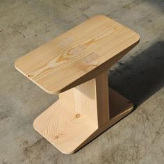 James Irvine for Discipline. Created using larch wood and oak, the design uses no glue or screws. Instead sections are slotted together using a system of tenons and wedges.