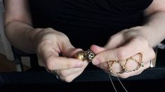 Product Video: Wendy Brandes Acorn Locket  This 18K yellow gold locket unscrews to reveal a tiny gold squirrel. The top of the acorn has a criss-cross pattern which mimics Victorian jewelry. The piece is handmade in New York City by exceptional craftsmen.
