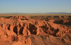 "South Gobi Desert. Bayanzag, ""The Flaming Cliffs"", site of amazing dinosaur fossil finds."
