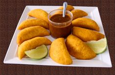 Colombian empanadas feature a crunchy cornmeal dough, filled with a creamy, aromatic beef and potato filling, spiced with cumin and Sazon.  These empanadas are a perfect appetizer for any party! Paired with Ají picante a spicy sauce that is an absolute must for Colombian Empanadas.