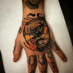 Hawk on hand tattoo by Conor Wearn