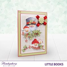 We are loving the decoupage layers on this card that is made from The Little Book of Cute Christmas!