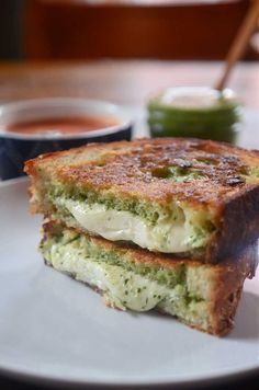 Pesto Mozzarella Grilled Cheese. Homemade pesto & fresh mozzarella cheese sandwiched between Parmesan crusted bread and then grilled to perfection << I'd add some bacon or something like that though