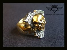 Damn! CooL! Skull, Lighting Bolt, And What Looks Like, The Top Of A Castle Wall.& Gold. Metal .