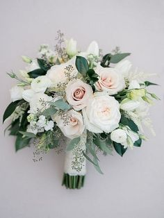 This white green and blush wedding bouquet is perfect for the simple, modern and elegant bride.