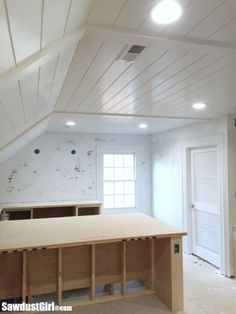 Plywood Plank Ceiling.  This cost only $400 vs $3000 for Pine tongue and groove!