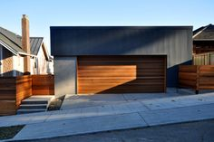 Spectacular Modern Garage with Contemporary Garage Doors: Mesmerizing Contemporary Garage Doors Tesla For Simple Home Design Ideas Gray Paint Wall Mixed With Wooden Door ~ workdon.com Doors Designs Inspiration