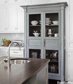 I love incorporating seperate furniture into a kitchen design