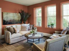 Benjamin Moore Paint Colors - Orange Living Room Ideas - Rich Orange Living Room - Paint Color Schemes . . . . . To brighten neutral furnishings and flooring, add a warm layer of rust. . . . . . Walls - Audubon Russet (HC-51); Ceiling - Hush (AF-95); Trim - Mascarpone (AF-20).