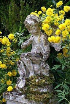 my french country home: Visiting our valley. Vintage concrete garden cherub amount bright yellow flowers in a French garden bed. Parks, My French Country Home, Concrete Garden, My Secret Garden, Secret Gardens, Garden Statues, Cement Statues, Garden Sculptures, Garden Ornaments