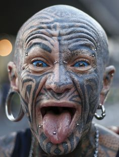 A man with tattoos and piercings is seen before the start of the 92nd Sao Silvestre international 15 km race in Sao Paulo, Brazil, on 31 December 2016. Thirty thousand runners participated in the 15 km traditional New Year's Eve event. Miguel...