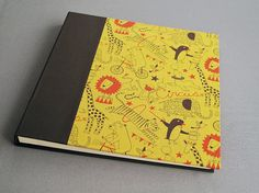 "IONA BINDING - Handmade photo album measures 13,18"" x 13,58"". Covered with Japanese fabric and brown fabric."