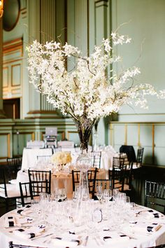 the only way to do tall centerpieces - so tall that everyone can see around them