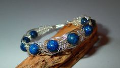 Herringbone wire wrapped bracelet with Lapis Lazuli by LaSolis, Wire Wrapped Bracelet, Heart And Mind, Wire Work, Lapis Lazuli, Herringbone, Wire Wrapping, Polymer Clay, Sapphire, Handmade Jewelry