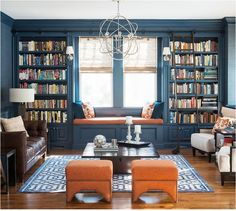 blue painted built ins library cory conner  -- Love the book shelves and the ladder