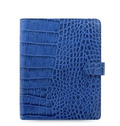 Filofax Classic Croc Organiser in indigo blue textured crocodile effect Italian calf leather. Available in A5 and personal size. 6 ring binder for planning your goals and organising your life comes with a selection of inserts including week on two page diary. Two elastic pen loops. Zip pocket in the front can be used as a wallet. Plus nine credit card sized slots inside of the back cover. Leather strap fastening with concealed popper. Colour Crush and Kikki K inserts also fit this Filofax.