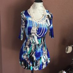 Accordion pleated colorful silky top This pretty top has a scoop neck and elbow length sleeves. Washes beautifully dry flat... NO IRON!!! Yay!!! 100% poly so it's easy care! Great top to add a splash of color to any outfit!!!                M2 Mini pleats Tops Blouses