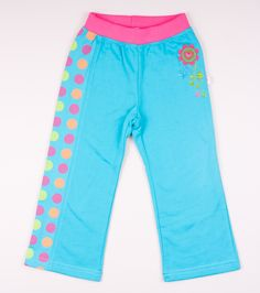 Sweatpants for girl with elastic band at waist. Made of 100% cotton. Pattern with big, color dots print on one leg. Flower motif on the front.