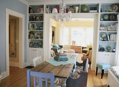 book shelves around door and long, thin table.