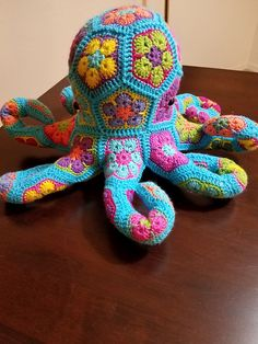 From the deep dark depths of the oceans comes the lovable and sometimes hugs a little too tight, Octavius the African Flower Octopus. Toys Patterns african flowers Octavius the African Flower Octopus pattern by LineandLoops Octopus Crochet Pattern, Granny Square Crochet Pattern, Crochet Animal Patterns, Afghan Crochet Patterns, Stuffed Animal Patterns, Amigurumi Patterns, Crochet Eyes, Crochet Teddy, Crochet Dolls